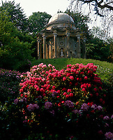 View over the rhododendrons to the magnificent Temple of Apollo at Stourhead