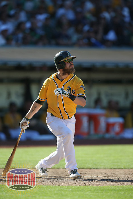 OAKLAND, CA - JUNE 13:  Josh Reddick #16 of the Oakland Athletics bats against the New York Yankees during the game at O.co Coliseum on Thursday June 13, 2013 in Oakland, California. Photo by Brad Mangin