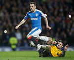 Gregor Buchanan puts a robust tackle in on Nicky Clark