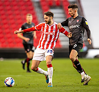 31st October 2020; Bet365 Stadium, Stoke, Staffordshire, England; English Football League Championship Football, Stoke City versus Rotherham United; Nick Powell of Stoke City under pressure from Daniel Barlaser of Rotherham United