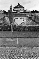 Switzerland. Canton Fribourg. Morat. Private houses and public parking place. A heart is painted on the wall. Murten (German) or Morat (French) is a municipality in the See district of the canton of Fribourg. 23.05.2016 © 2015 Didier Ruef