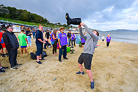 BNPS.co.uk (01202 558833)<br /> Pic: Graham Hunt/BNPS<br /> <br /> With the Olympics coming to an end holidaymakers and Lyme Regis locals made their fun in the form of competitive 'Welly Wanging'.<br /> <br /> Holidaymakers and locals compete in the over 12's section of the Welly Wanging competition on the beach at the seaside resort of Lyme Regis in Dorset during the towns Regatta and Carnival Week.<br /> <br /> The aim of the Welly Wanging is to throw a boot full of water over your head as far as possible with each competitor getting three attempts.