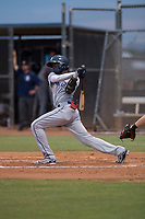 AZL Padres 1 third baseman Luis Guzman (7) follows through on his swing during an Arizona League game against the AZL Padres 2 at Peoria Sports Complex on July 14, 2018 in Peoria, Arizona. The AZL Padres 1 defeated the AZL Padres 2 4-0. (Zachary Lucy/Four Seam Images)