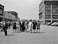 Workers coming out of the Highland Park Chrysler plant. Detroit, Michigan. Spring, 1942.<br /> <br /> Photo by Arthur S. Siegel.