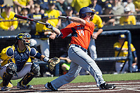 Illinois Fighting Illini outfielder Dan Rowbottom (19) follows through on his swing against the Michigan Wolverines during the NCAA baseball game on April 8, 2017 at Ray Fisher Stadium in Ann Arbor, Michigan. Michigan defeated Illinois 7-0. (Andrew Woolley/Four Seam Images)