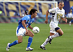 Mexico (18.02.2006) UNAM Pumas defender Dario Veron (R) battles for the ball against Cruz Azul forward Cesar Delgado as he scores the second goal of his team during their soccer match at the Blue Stadium in Mexico City, February 18, 2006. Cruz Azul won 3-1 to UNAM. © Photo by Javier Rodriguez/
