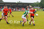 Wk27 Na Gael's Jack Sheehanl under pressure from Adrian O'Connor in the 10pt to 1-7 draw in Glenbeigh on Sunday