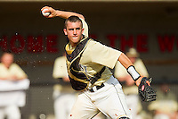 Wake Forest Demon Deacons catcher Matt Martin #4 makes a throw to first base against the North Carolina State Wolfpack at Doak Field at Dail Park on March 17, 2012 in Raleigh, North Carolina.  The Wolfpack defeated the Demon Deacons 6-2.  (Brian Westerholt/Four Seam Images)