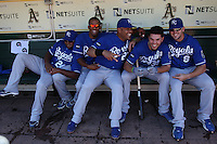 OAKLAND, CA - SEPTEMBER 7:  Yamaico Navarro #24, Salvador Perez #13, Brayan Pena #27, Eric Hosmer #35, and Mike Moustakas #8 of the Kansas City Royals joke around in the dugout before the game against the Oakland Athletics at O.co Coliseum on September 7, 2011 in Oakland, California. Photo by Brad Mangin