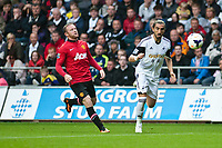 Saturday 17 August 2013<br /> <br /> Pictured: Chico Flores of Swansea and Wayne Rooney of Manchester United<br /> <br /> Re: Barclays Premier League Swansea City v Manchester United at the Liberty Stadium, Swansea, Wales