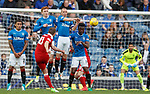 Niall McGinn curls a ball around the wall but Wes Foderingham tips it over
