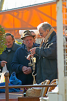 Men selling, buying and weighing truffles on an old fashioned scale at the truffles market in Carpentras, Vaucluse, Rhone, Provence, France