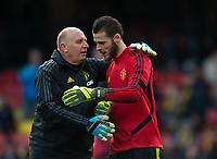 Man Utd Goalkeeping coach Richard Hartis and Goalkeeper David De Gea of Man Utd during the Premier League match between Watford and Manchester United at Vicarage Road, Watford, England on 22 December 2019. Photo by Andy Rowland.