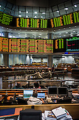 Traders and stock owners are seen on the floor of the RHB Investment Bank in Kuala Lumpur, Malaysia. Photo: Sanjit Das/Panos