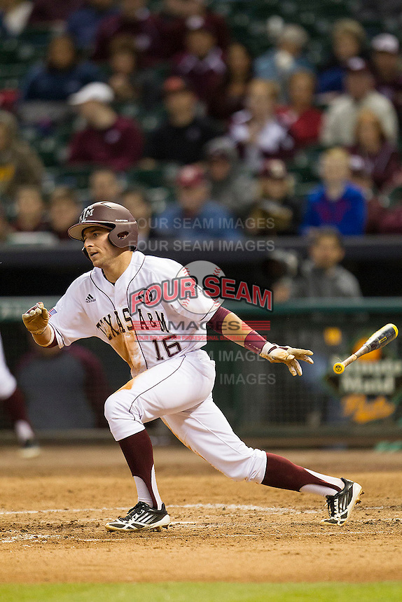 Texas A&M Aggie shortstop Mickey Reynolds #16 follows through on his swing against the Houston Cougars in the NCAA baseball game on March 1st, 2013 at Minute Maid Park in Houston, Texas. Houston defeated Texas A&M 7-6. (Andrew Woolley/Four Seam Images).