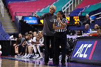 GREENSBORO, NC - MARCH 05: Head coach Nell Fortner of Georgia Tech discusses a call with official Talisa Green during a game between Pitt and Georgia Tech at Greensboro Coliseum on March 05, 2020 in Greensboro, North Carolina.