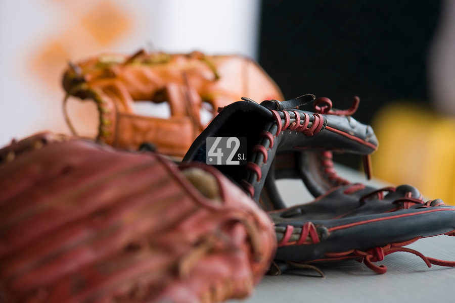 18 August 2007: Baseball gloves lie in the dugout during the China 5-1 victory over France in the Good Luck Beijing International baseball tournament (olympic test event) at the Wukesong Baseball Field in Beijing, China.