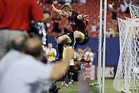 The MetroStars' John Wolyniec celebrates the game winning goal by jumping over the ad boards. The Chicago Fire were defeated by the NY/NJ MetroStars 2-1 at Giant's Stadium, East Rutherford, NJ, on July 24, 2004.