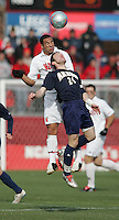DEC 3, 2005: College Park MD, USA: Maryland Terrapins midfielder (5) A.J. Godbolt goes up for a header against Akron Zips midfielder (24) Johann Mauger at Ludwig Field. Mandatory Credit: Photo By Brad Smith-International Sports Images (c) Copyright 2005 Brad Smith