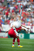 USA's Clarence Goodson goes over the back of.Turkey's Hamit Altintop during an international friendly tune up match for the 2010 World Cup, at Lincoln Financial Field, in Philadelphia, PA, Saturday, May 29, 2010. USA defeated Turkey 2-1.