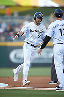 Matt Skole (21) of the Charlotte Knights rounds third base after hitting the first of two home runs on the night against the Rochester Red Wings at BB&T BallPark on May 14, 2019 in Charlotte, North Carolina. The Knights defeated the Red Wings 13-7. (Brian Westerholt/Four Seam Images)