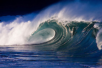 Beautiful large wave cresting at the shore break of Waimea Bay on the island of Oahu, Hawaii.