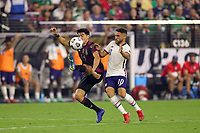 LAS VEGAS, NV - AUGUST 1: Erick Gutierrez #14 of Mexico battles for the ball with Cristian Roldan #10 of the United States during a game between Mexico and USMNT at Allegiant Stadium on August 1, 2021 in Las Vegas, Nevada.