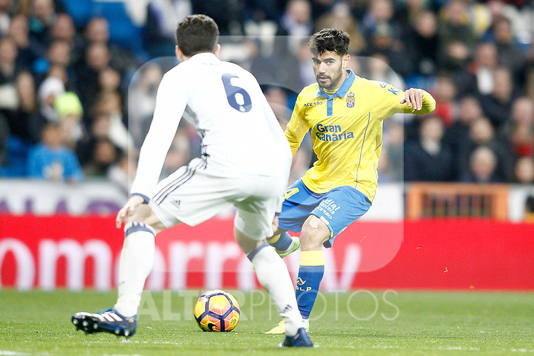 Real Madrid's Nacho Fernandez (l) and UD Las Palmas' Tana Dominguez during La Liga match. March 1,2017. (ALTERPHOTOS/Acero)