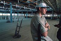 Bale Handler Peter Lane, Mareeba Sales Floor, Mareeba, 2003.