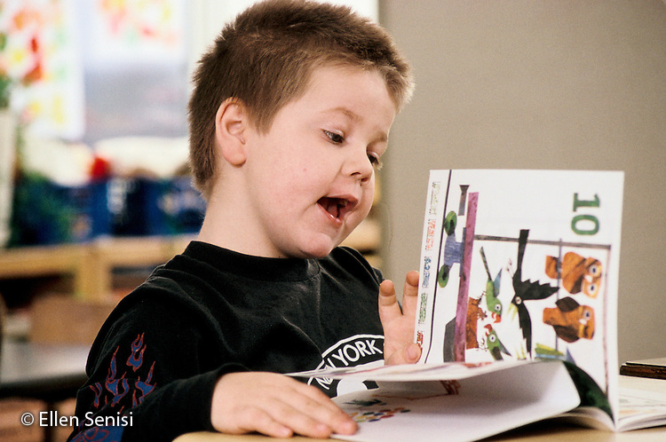 MR / Schenectady, NY.Yates Arts Magnet School / Special Education Class.Boy (8, Learning Disabled, ADHD, on Ritalin) Special Education placement with some mainstreaming in Grade 2) reads at free time..MR: Swi2.PN#: 20357                    FC#: 22135-00705.scan from slide.©Ellen B. Senisi