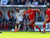 FAO SPORTS PICTURE DESK<br /> Pictured L-R: Scott Sinclair of Swansea against Martin Kelly of Liverpool. Sunday, 13 May 2012<br /> Re: Premier League football, Swansea City FC v Liverpool FC at the Liberty Stadium, south Wales.