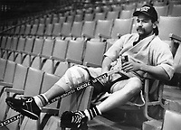 Waiting Room: An alling right knee, courtesy of a Devil-ish bodycheck a few weeks ago, has kept Leaf winger Wendel Clark off the Ice. But it didn't keep him away from yesterday's team practice. Just sit back, crack open a tin of tomato juice and watch.<br /> <br /> Photo : Boris Spremo - Toronto Star archives - AQP