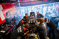 Jul 12, 2020; Clermont, Indiana, USA; Crew members surround the car of NHRA funny car driver Alexis DeJoria as she warms up her engine in the pits during the E3 Spark Plugs Nationals at Lucas Oil Raceway. This is the first race back for NHRA since the start of the COVID-19 global pandemic. Mandatory Credit: Mark J. Rebilas-USA TODAY Sports