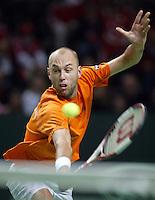 04-03-2006,Swiss,Freibourgh, Davis Cup , Swiss-Netherlands, Peter Wessels in actie tegen  Stanislas Warinka
