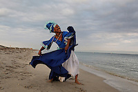 Marisol Blanco dancing the Yemaya on the beach at Bill Baggs State Park. The color of her dress symbolizes water--and it gives life to all things. ..