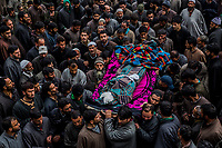 HIRPORA, SHOPIAN DISTRICT, INDIAN ADMINISTERED KASHMIR, INDIA  - APRIL 25, 2014: Family and friends mourn the death of Zia-ul Haq, 29, a Kashmiri primary school teacher and election official during his funeral on April 25, 2014 in the village of Hirpora, approximately 60km's south of Srinagar, Shopian District, Indian administered Kashmir. Zia, an Indian poll official was killed soon after voting for the ongoing general elections, when suspected rebels fatally shot him and wounded four others in an attack on a bus in the Indian-controlled portion of Kashmir. Voter turnout was extremely low across the district, with voting being boycotted in villages with numerous polling stations not even registering one vote. <br /> <br /> Daniel Berehulak for The New York Times