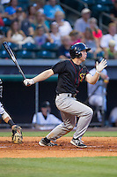 Brett Phillips (8) of the Quad Cities River Bandits follows through on his swing against the Bowling Green Hot Rods at Bowling Green Ballpark on July 26, 2014 in Bowling Green, Kentucky.  The River Bandits defeated the Hot Rods 9-2.  (Brian Westerholt/Four Seam Images)