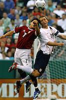 Edgard Jimenez goes up against Jimmy Conrad. USA (2) vs Venezuela (0) at Browns Stadium in Cleveland, Ohio, May 26, 2006.