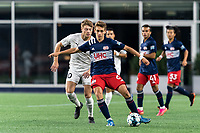 FOXBOROUGH, MA - SEPTEMBER 1: Noel Buck #61 of New Englans Revolution II passes the ball as Charlie Dennis #10 of FC Tucson pressures during a game between FC Tucson and New England Revolution II at Gillette Stadium on September 1, 2021 in Foxborough, Massachusetts.