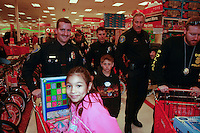 Cops and kids crowd the aisles at the Sports Arena Target store in San Diego for the annual Shop-with-a-Cop event on December 1, 2007.  Three hundred disadvantaged kids were paired up with cops for the event.  They were treated to breakfast at SeaWorld before driving to the store in a convoy of more than three hundred police vehicles with sirens blaring, lights flashing and Santa waving from a police helicopter hovering above them.  Some of the children rose well before dawn in order to be ready for the fleet of buses that collected them from every corner of the county.  Each child had a $100 gift card to spend and many of the children choose to buy clothes, for themselves, their siblings or parents instead of toys.