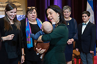 Montreal Mayor Valerie Plante holds a great grandchild of Lise Payette during a memorial service in her honour at City Hall in Montreal, Saturday, October 20, 2018. THE CANADIAN PRESS/Graham Hughes