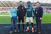 Wilfried Bony of Swansea City and Andrew Surman of Bournemouth with LGBT representatives from both clubs prior to kick off of the Premier League match between Swansea City and Bournemouth at the Liberty Stadium, Swansea, Wales, UK. Saturday 25 November 2017