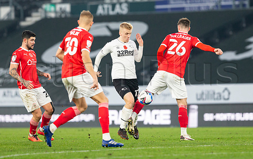 7th November 2020; Pride Park, Derby, East Midlands; English Football League Championship Football, Derby County versus Barnsley; Louie Sibley of Derby County makes his way past Michael Sollbauer of Barnsley with the ball