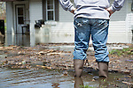 Man standing in front of flooded house