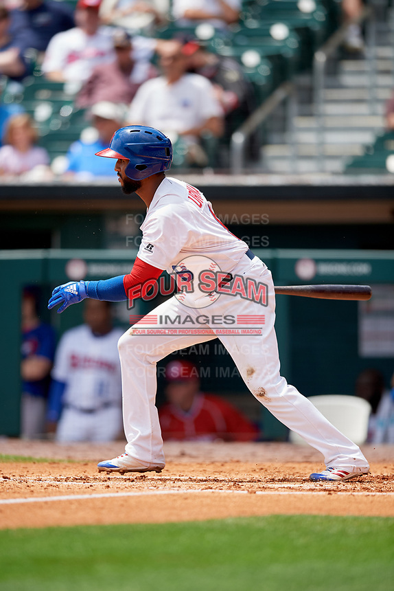 Buffalo Bisons second baseman Richard Urena (8) follows through on a swing during a game against the Pawtucket Red Sox on June 28, 2018 at Coca-Cola Field in Buffalo, New York.  Buffalo defeated Pawtucket 8-1.  (Mike Janes/Four Seam Images)