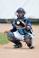 Catcher Gerardo Olivares #28 of the Princeton Rays warms up his starting pitcher prior to the start of the Appalachian League game against the Bluefield Orioles at Hunnicutt Field July 4, 2010, in Princeton, West Virginia.  Photo by Brian Westerholt / Four Seam Images