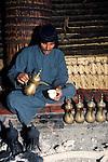 Marsh Arabs. Southern Iraq. Marsh Arab man pouring coffee. Haur al Mamar or Haur al-Hamar marsh collectively known now as Hammar marshes Iraq 1984