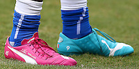 The personalised odd coloured Puma football boots of Mario Balotelli of Italy with 'Super Mangel' stitched into them