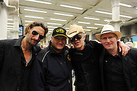 Pop group Alabama 3 serenade 200 RMT activist at 7.30 am in the St Pancras Eurostar Terminal London. The RMT were leaving to attend protest  at the offices of the European Rail Agency.