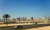 Dubai.  Skyline of the Jumeirah Developments, Emirates Lakes Towers and the Marina Development with new housing developments and new road in the foreground..